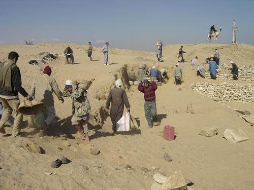 Egyptian workmen clearing away sand in the north-west corner of Teti's pyramid cemetery,early Dynasty 6 (2345-2323 BCE), Saqqara.