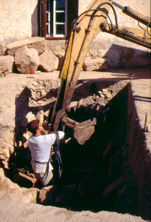 Using a backhoe to remove ashlar blocks