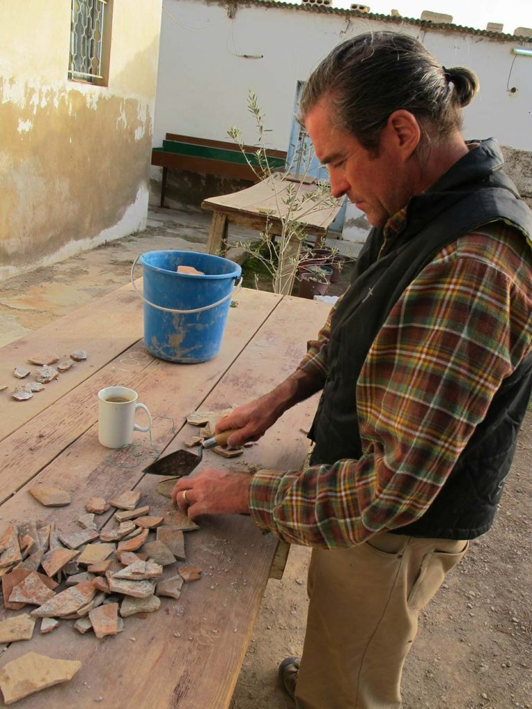 Paul working with sherds