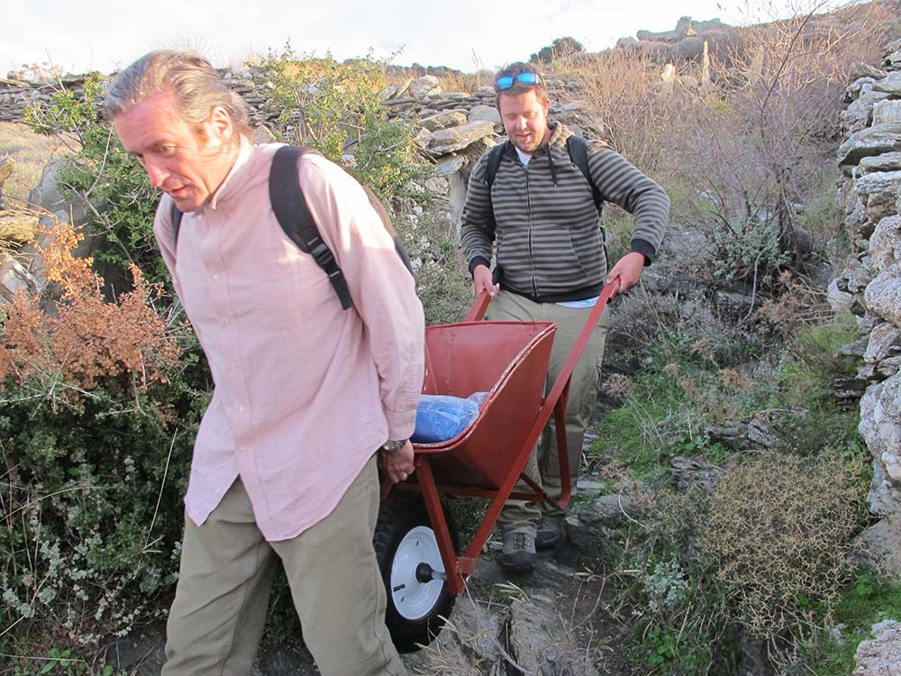 Paul Donnelly and Hugh Thomas carrying a wheelbarrow down to the Zagora site