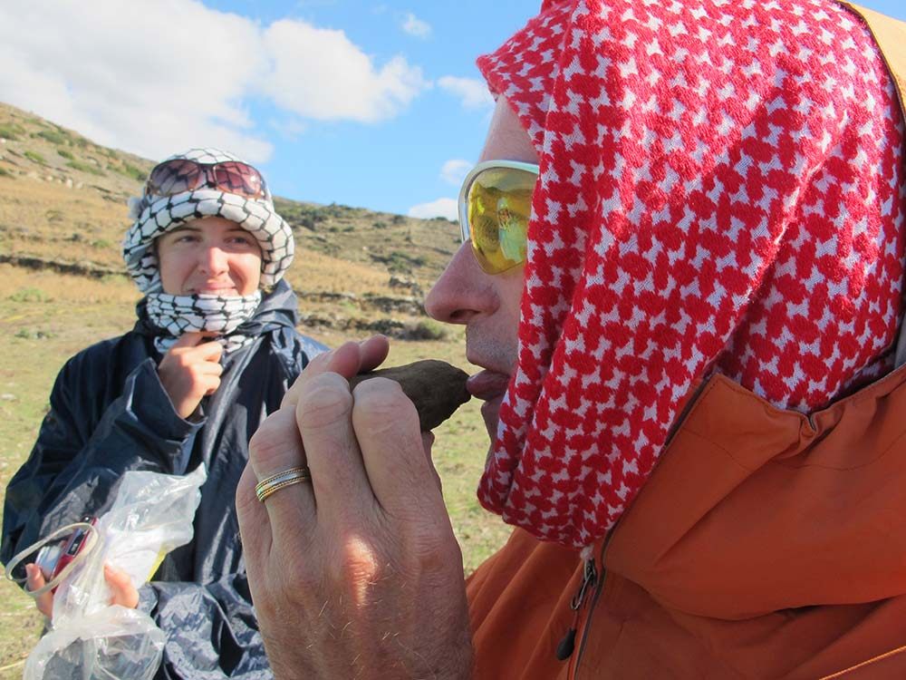Dr Paul Donnelly licking to check whether an object is a sherd or a stone
