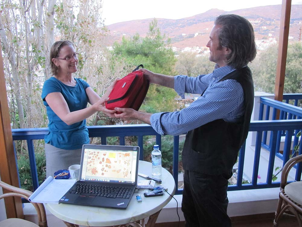 Paul Donnelly handing the tablets to Beatrice McLoughlin