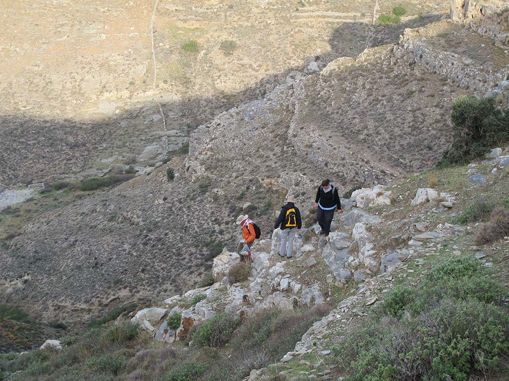 Paul Donnelly, Jane McMahon and Taryn Gooley walking down the steep slope to do a transect survey