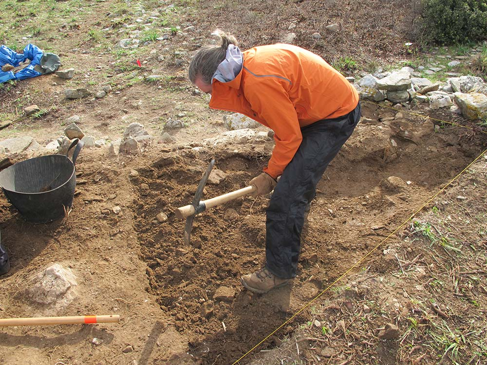 Paul Donnelly using a pick in test trench 2