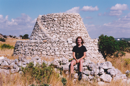 Resting on a trullo wall after a hard day's survey. Apulia 2001