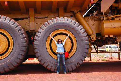 Guadalupe in front of a giant haul truck at Newman in WA
