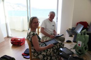 Beatrice McLoughlin and Andrew Wilson in the Zagora office in Batsi during the 2013 season.