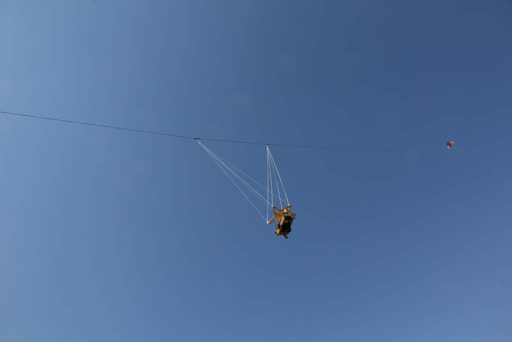 The camera with the kite beyond