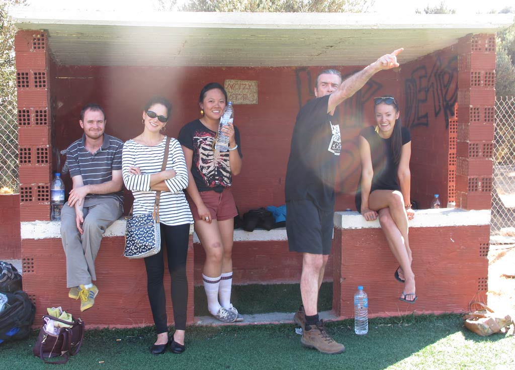 Some of our Zagora soccer team supporters, from left: Damien Stone, Julia Manouras, Elaine Lin, and Natasha Nassenstein. Paul Donnelly (second from right), one of the players, has had enough and is hailing a taxi to go home