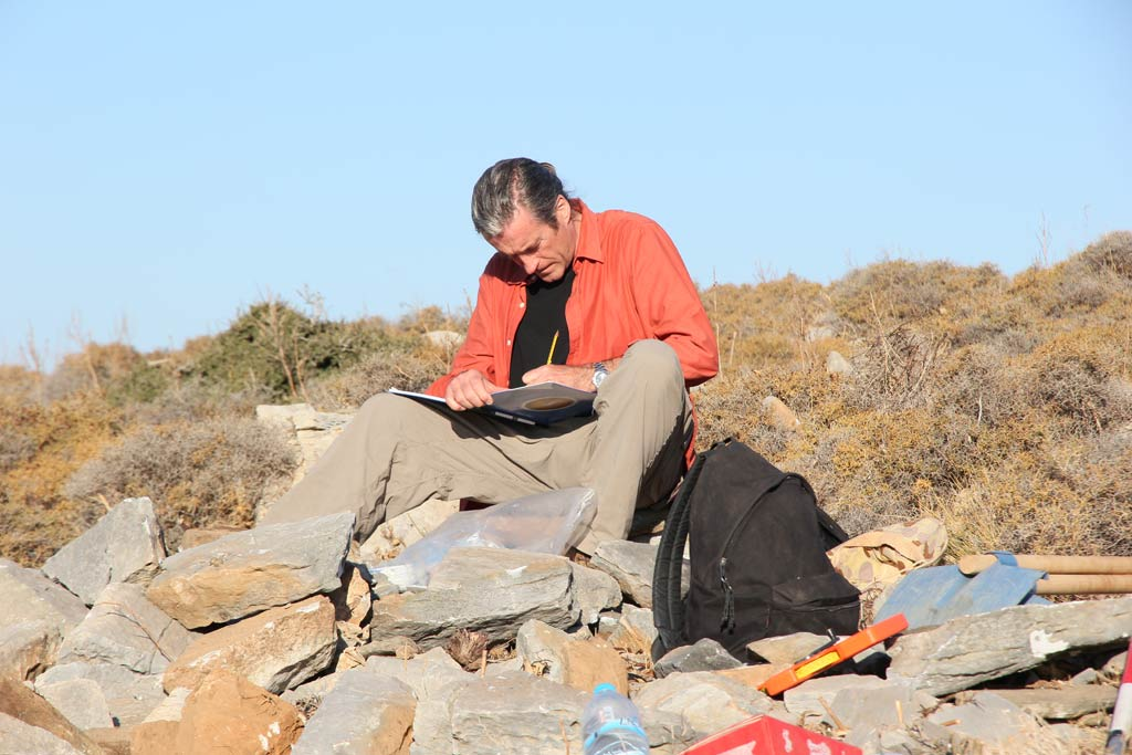 Paul Donnelly writing in his notebook at Excavation Area 5