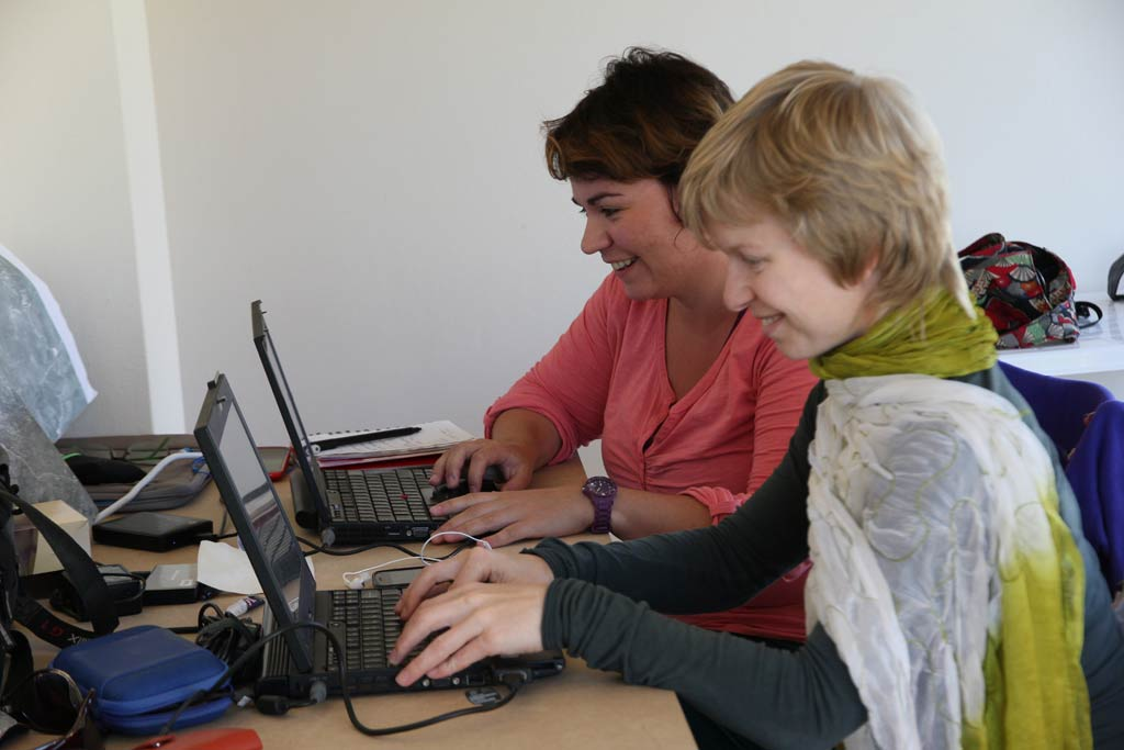 Petra Janouchova and Adela Sobotkova working in the Zagora office at Batsi
