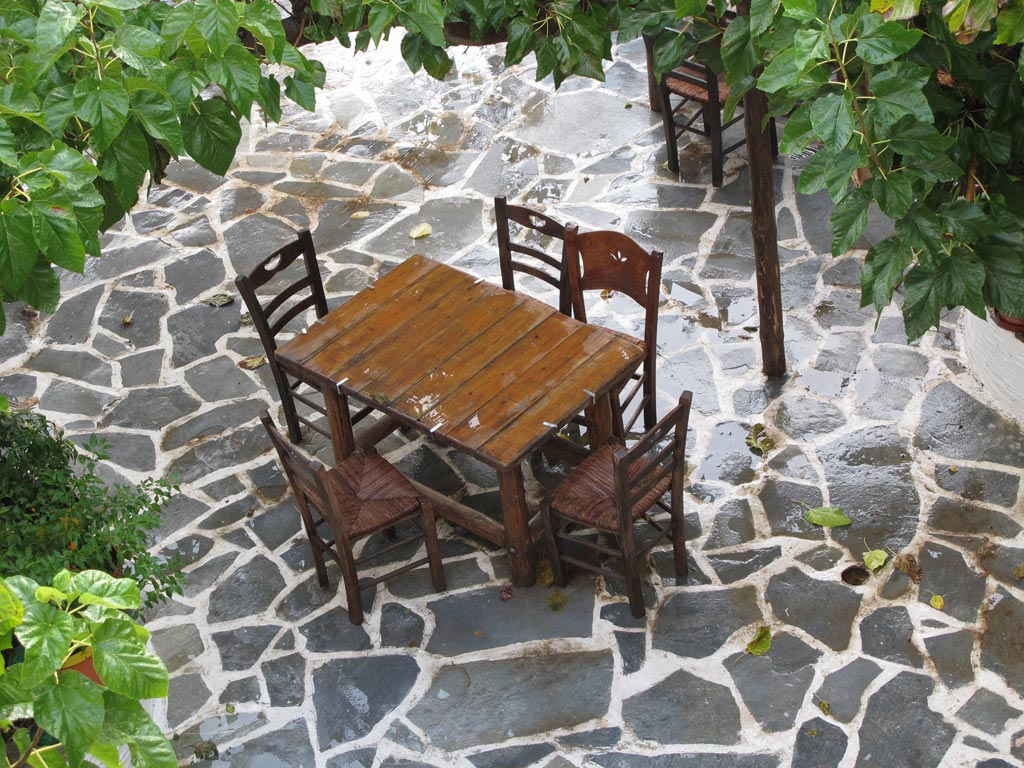 Kantouni courtyard with chairs after a shower