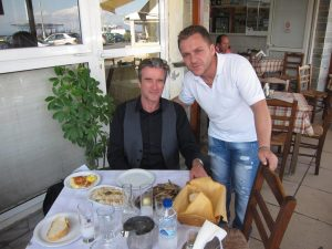 Paul Donnelly with our host at the seaside pavement cafe in Rafina