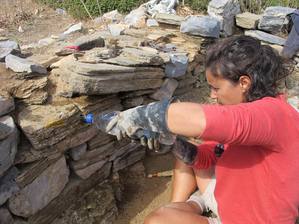 Stefie has developed effective techniques with a limited budget - she makes a few holes in the tops of plastic water bottles which make ideal tools for wetting the mortar so it is the right consistency for working between the stones.
