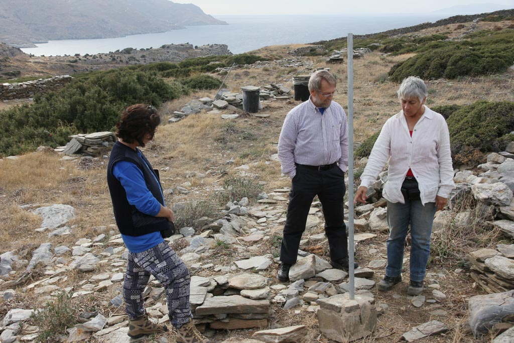 Lesley Beaumont, Jim Coulton and Meg Miller considering the poles which will become fenceposts to protect the temple remains at Zagora
