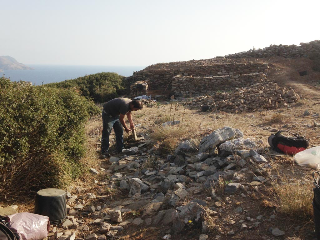 Giorgos Moustakas from Batsi selecting stones for the backfilling