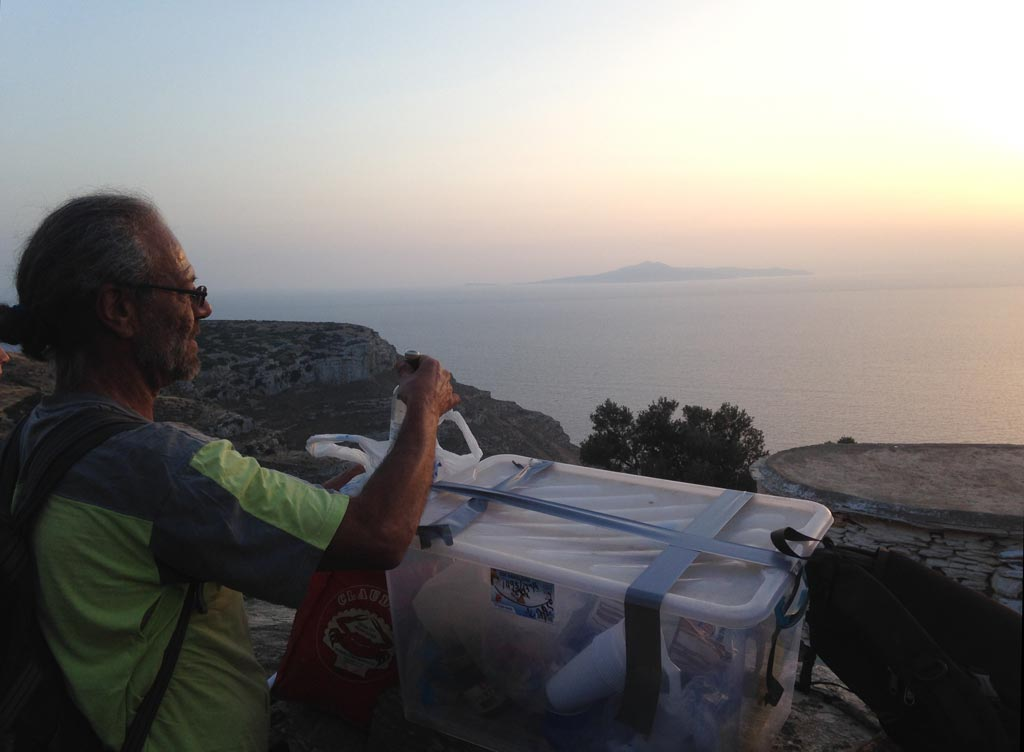 Steve Vasilakis takes a moment to savour the sunset on the path up the hill from Zagora after a hard day's backfilling