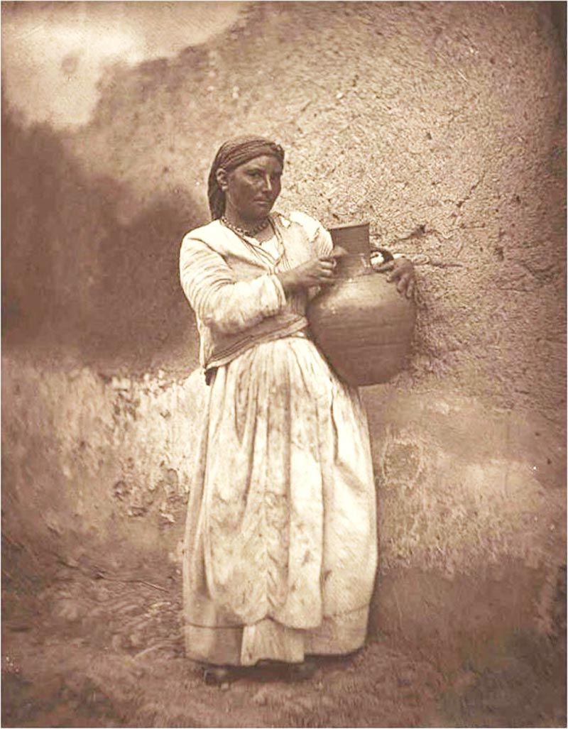 A woman carrying a hydria in Tinos in the early 20th century