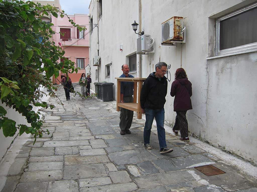 Our crew making our way to the Andros Archaeological Museum one morning. In the foreground, Bob Miller and Stavros Paspalas carry a light table into the Museum lab where Bob will take photographs of artefacts. This table was made on the island to Bob's specifications